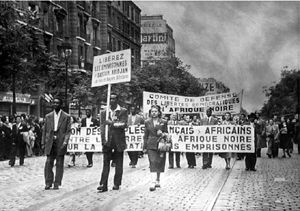 Cheikh Anta Diop (with the placard) and his wife Louise Marie (in the right), demonstrating in Paris for African politicians' release 50s